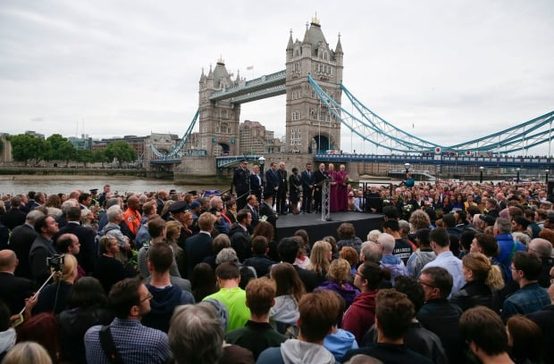People gather for a vigil in Potters Fields Park in London