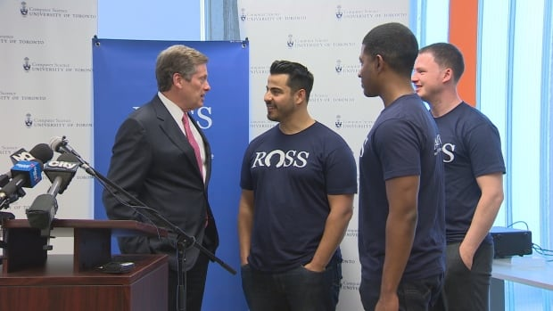 Mayor John Tory speaks with the founders of ROSS Intelligence after the company announced the opening of its Toronto research and development centre.