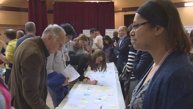 To be or not to be: community members, politicians and local business owners gathered at Trinity-St. Paul's Centre to discuss Bloor bike lanes.