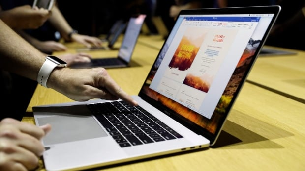 A new MacBook is demonstrated at the Apple Worldwide Developers Conference Monday in San Jose , Calif.