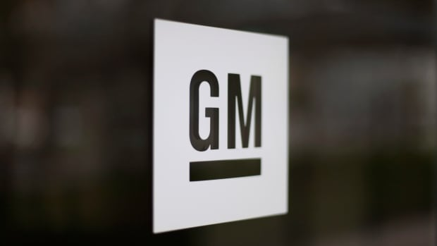FILE - This May 16, 2014, file photo, shows the General Motors logo at the company's world headquarters in Detroit. GM said it is making the first mass-production autonomous car without a steering wheel or pedals.
