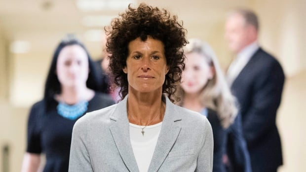Andrea Constand is seen walking into the courtroom for Bill Cosby's sexual assault trial at the Montgomery County Courthouse in Norristown, Pa., on Tuesday. Cosby is charged with sexually assaulting Constand at his suburban Philadelphia estate in 2004.