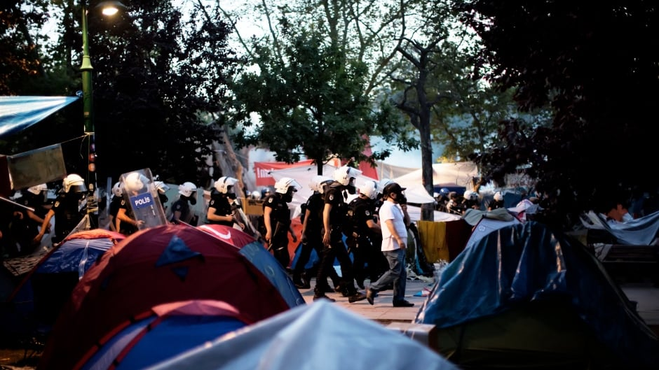 Turkish riot police dismantle the tent camp set up by demonstrators in Gezi Park in Istanbul on June 15, 2013.