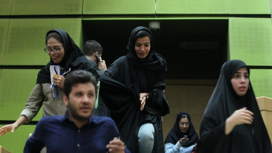 Women are seen inside the parliament during an attack in central Tehran on Wednesday.