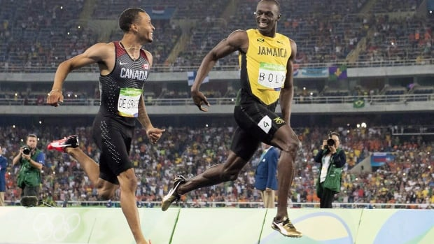 Andre De Grasse, left, and Usain Bolt share a laugh at the finish line during the 200-metre semifinals at the Rio Olympics last August.