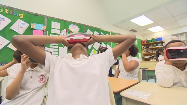 St Michael Catholic School grade four student Daniel Tesfu tries virtual reality for the first time.