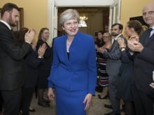 May announced her party will form a minority government, supported by Northern Ireland's Democratic Unionist Party.