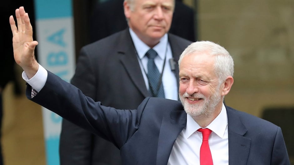 Britain's Labour party leader Jeremy Corbyn waves as he leaves the Labour party headquarters in London, Friday, June 9, 2017.  (AP Photo/Tim Ireland)