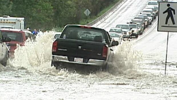 Rain forced the city to close lanes on 98th Avenue at 91st Street as flooding slowed the morning commute for thousands of Edmonton motorists on June 20, 2011.