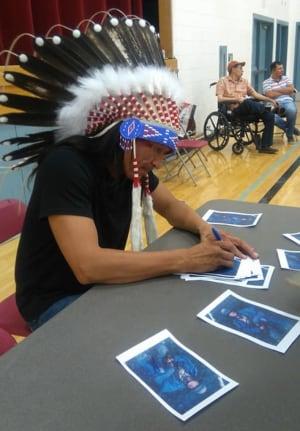 Eugene Brave Rock with headdress