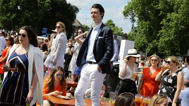 People attend a Polo event in Hurlingham Park in London Saturday. Londoners are being encouraged to go out Saturday night to partake in an initiative held by restaurants and bars in support of a Red Cross event for victims of the London Bridge attack.