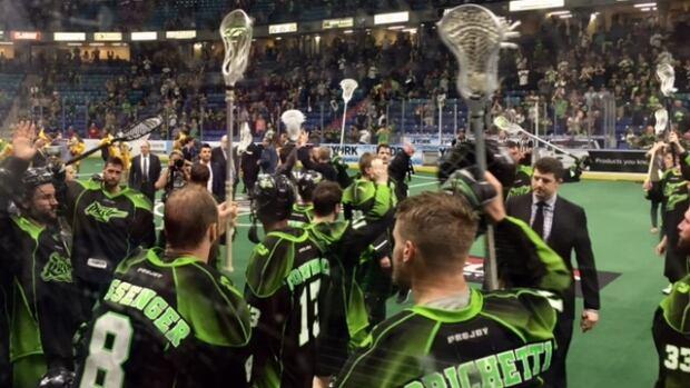 The Saskatchewan Rush thank their fans after losing 15-14 in OT Saturday night. (CBC)