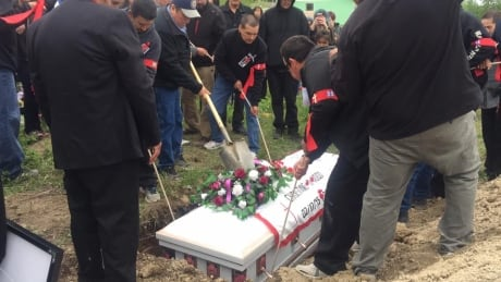 Christine Wood's casket was laid into the ground Saturday.