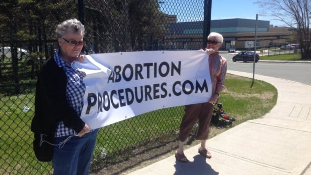 Anti-abortionists were outside the entrance to Waterford Valley High School on Topsail Road in St. John's on Monday.