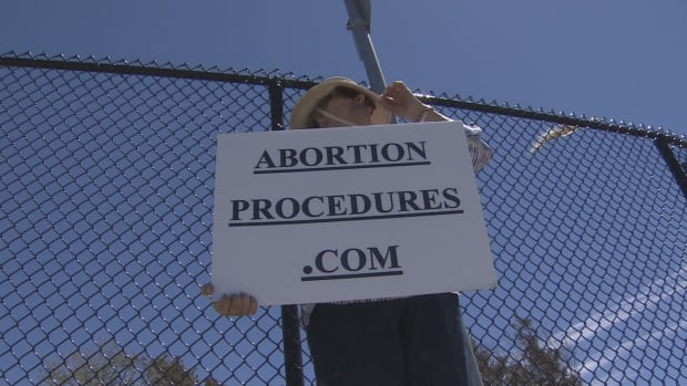 Anti-abortion protester with sign