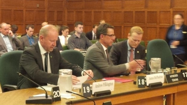 From left, Andrew Pilkington of TD Bank Financial Group, James McPhedran of Scotiabank and CIBC's Scott Wambolt prepare to testify before MPs on the Commons finance committee Monday.