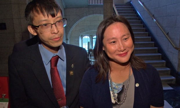 Liberal MP Arnold Chan and his wife, Jean