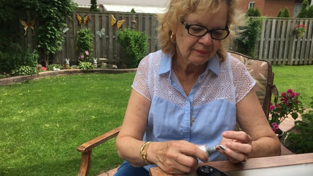 Margaret DeNobrega, 68, tests her blood sugar at her Toronto home. She was first diagnosed with Type 2 diabetes more than 15 years ago.