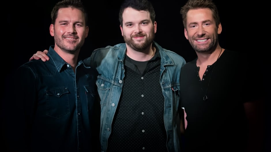 Tom Power poses with Ryan Peake (left) and Chad Kroeger (right) of Nickelback.