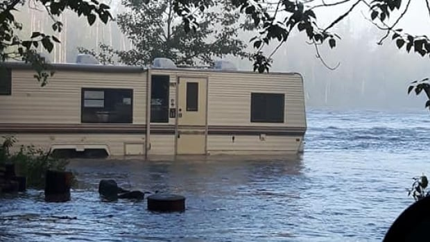 Campers along the Smokey River awoke to flooding on Saturday morning after heavy rain near Grande Prairie.