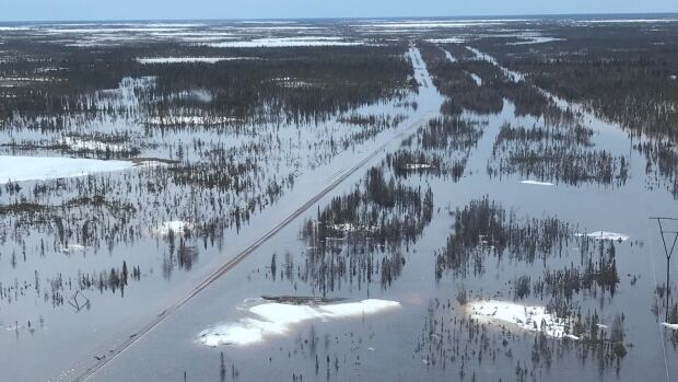 An aerial photograph shows the scale of damage OmniTrax has to deal with to restore train travel to Churchill.