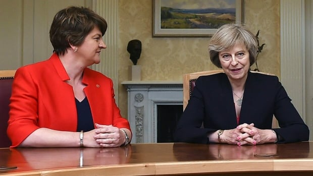 Democratic Unionist Party Arlene Foster, left, is seen with U.K. Prime Minister Theresa May during a meeting in Belfast in July 2016.
