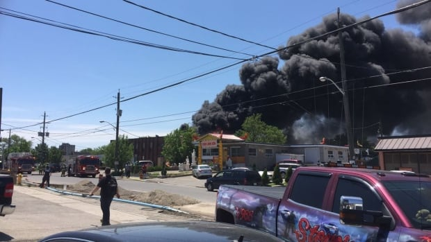 A former auto shop was engulfed in flames Wednesday afternoon.