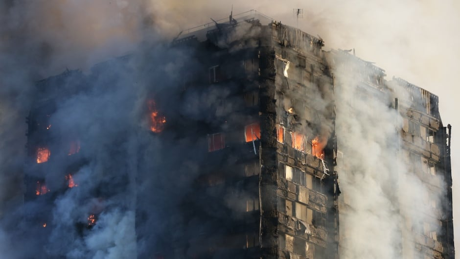 Smoke billows from Grenfell Tower as firefighters attempt to control a huge blaze in west London.