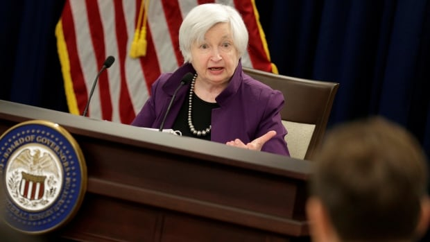 U.S. Federal Reserve chair Janet Yellen fields questions from reporters, many of whom asked why she is raising rates while inflation remains so low.