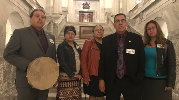 Sixties Scoop survivors (from left to right) Dave Herman, Kathy Hamelin, Lena Wildman, Adam North-Piegan and Sharon Gladue-Paskimin gather before meeting with provincial officials at the Alberta Legislative Building in Edmonton on Wednesday.