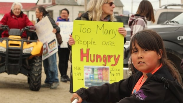 Protesters in Nain demonstrate outside the Northern Store against high food prices.