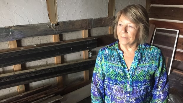 Heavily damaged by floodwater, the rental unit in Anny Coens's basement is now dry and gutted, but she can't begin to rebuild until she finds out how much government compensation she's due.