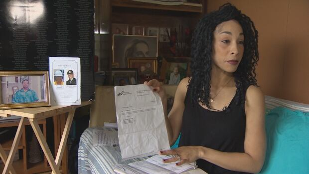 Lionel Desmond's sister, Cassandra Desmond, holds up a doctor's letter recommending that her brother attend the gym and yoga to help with his severe post-traumatic stress disorder.