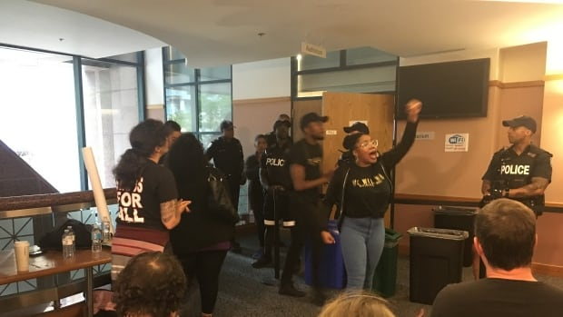 Protests delayed a meeting of the Toronto Police Services Board where members were considering whether to suspend a program that puts uniformed officers in some Toronto schools.