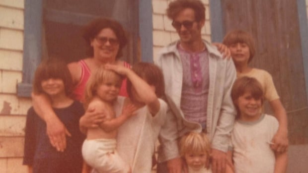 'Words cut deeper than a knife,' warned GeorgaDawn Moase's dad George Curtis, here with his wife and 6 children in about 1979. GeorgaDawn is the toddler in her sister's arms.