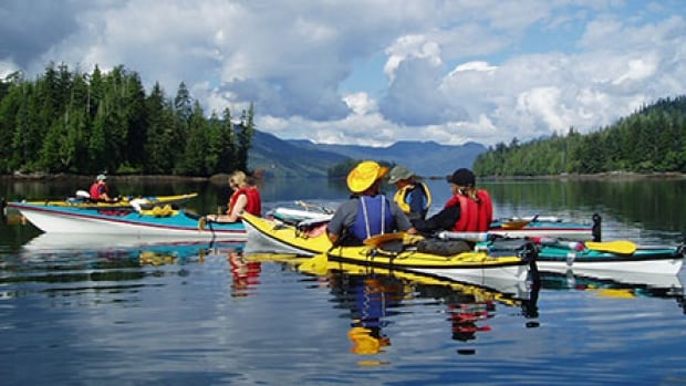 Kayakers in Gwaii Haanas National Marine Conservation Area, British Columbia.
