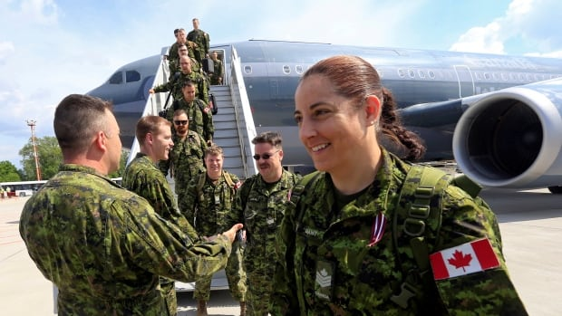 A NATO battle group with Canadian soldiers arrive at Riga International Airport in Latvia, on June 10. Canadian commanders have been warned to expect a barrage of negative Russian propaganda over the mission.