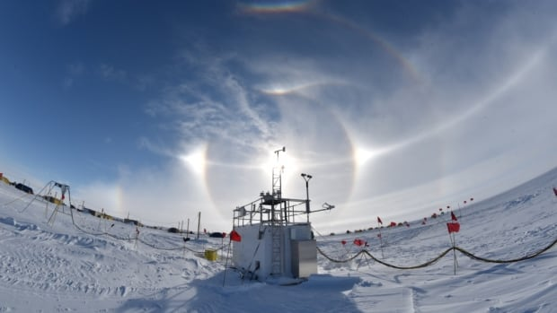Instruments that alerted scientists to unusually warm conditions at a field camp in central West Antarctica in December 2015 are seen here under an optical display known as a 'sun dog,' caused by atmospheric ice crystals.
