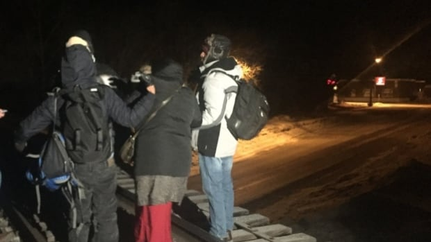 As the number of refugee claims being made in Canada continues to rise, advocates in Winnipeg are calling on the province and Ottawa to increase funding to deal with the number of cases. These seven refugees walked for hours to cross the Canada-U.S. border into Manitoba in February, 2017.
