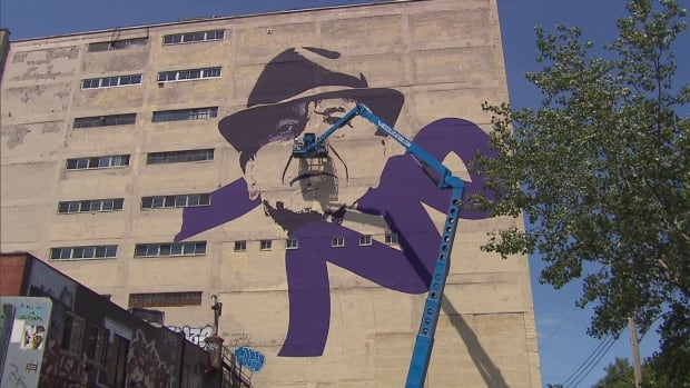 Artist Kevin Ledo said his mural represents the darkness and the energy surrounding Leonard Cohen's later work.
