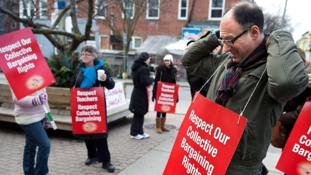 Striking teachers stand on a picket line in Toronto on Tuesday December 18, 2012. The Elementary Teachers' Federation of Ontario says it's going back to court after failing to agree with the province on a remedy for the government's violation of education workers' rights.