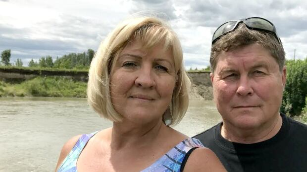 Julie Alm and husband Mark Shearer say they haven't been able to live on their property near Aldersyde since the 2013 flood.