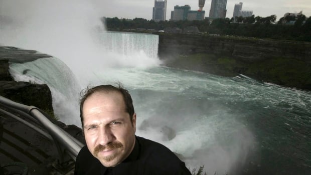 FILE- In this Aug. 13, 2004, file photo, Kirk Jones poses for a photo at Terrapin Point on the American side of Horseshoe Falls in Niagara Falls State Park, N.Y. Jones, who survived a plunge over Niagara Falls without protection in 2003 has died after he went over again, this time inside an inflatable ball.