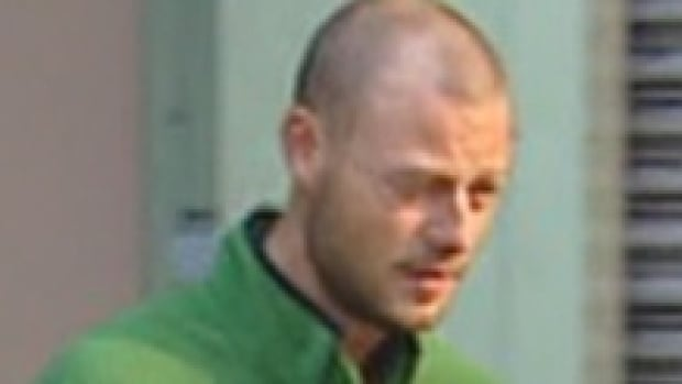 Brian Whitlock, seen leaving B.C. provincial court in Vancouver in 2012, had prior conviciton for cruelty to an animal.