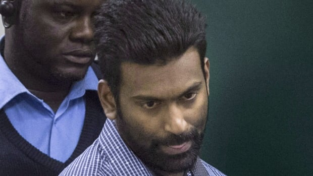 Sivaloganathan Thanabalasingam arrives for a detention review at the Immigration and Refugee Board of Canada in Montreal on April 13. He is due to be deported to Sri Lanka after a first-degree murder charge in the killing of his wife was stayed.