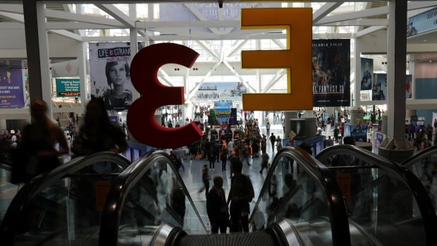 Attendees arrive at the E3 2017 Electronic Entertainment Expo in Los Angeles on June 13.