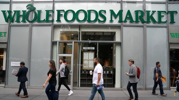 Whole Foods has cut some prices in the wake of a takeover by Amazon, but experts suggest Canadians shouldn't expect a price war to break out in the grocery industry.