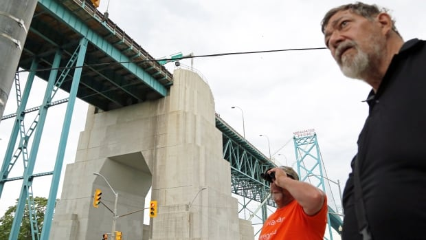 Wayne Hickson (left) and Steve Atkins, are members of the Canadian Peregrine Falcon Watch, a volunteer group that looks out of baby birds born under the Ambassador Bridge.