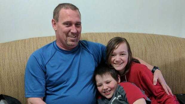 Orion Fike, 45, with his children Paige, 14, and Graydon, 9 at their Marlborough home in Calgary. Graydon is diagnosed with severe autism and ADHD, and did not utter his first words until the age of four.