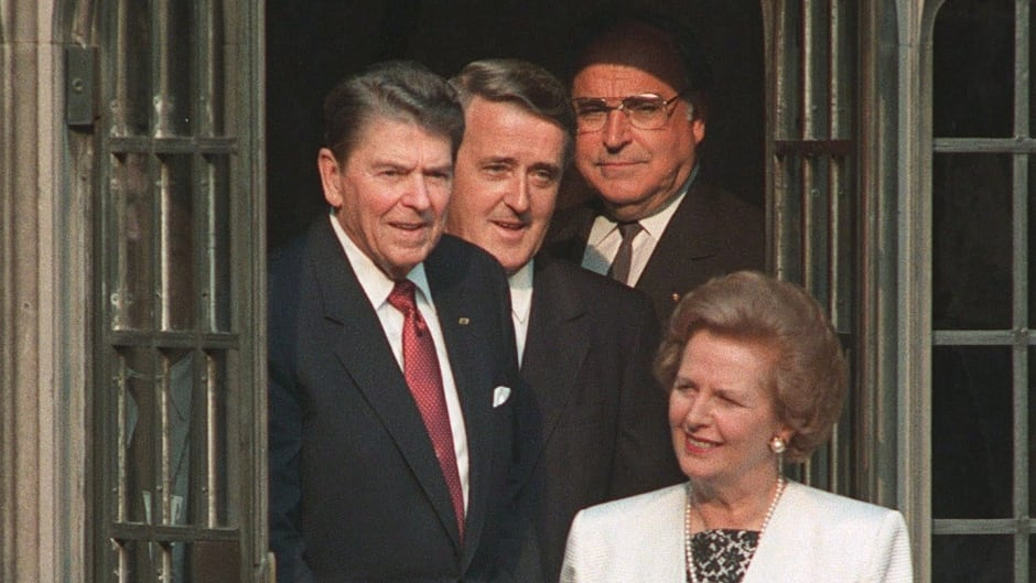 Ronald Reagan, Brian Mulroney and Helmut Kohl follow Margaret Thatcher into a courtyard at Hart House in Toronto, June 20, 1988.